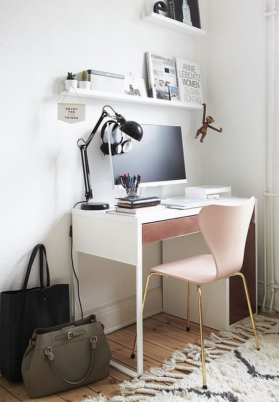 a girlish workspace with a Micke desk with a dusty pink drawer and a matching chair with brass legs