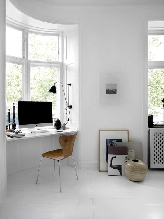 a small rounded niche with a windowsill used as a desk is a great idea to incorporate into a bedroom