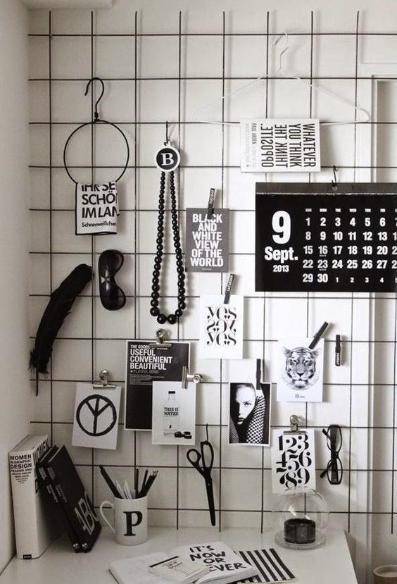 paint the grid with black paint and use it to hang all kinds of pieces and photos