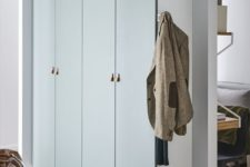 11 IKEA Pax hack in a muted green shade and with tiny leather pulls is very stylish