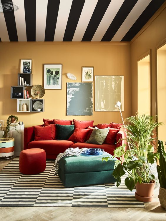 a colorful space with an orange Stockholm sofa and a green ottoman for a colorful touch