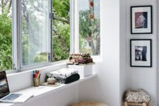 11 a window with a narrow windowsill used as a desk and for storage