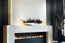 11 an ultra-modern ethanol fireplace in black and white will be a refined feature