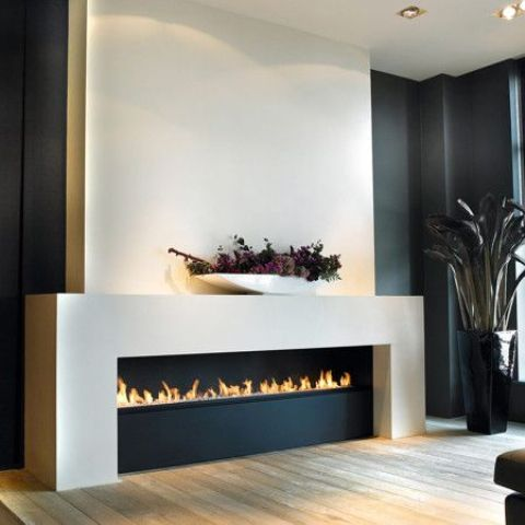 an ultra-modern ethanol fireplace in black and white will be a refined feature