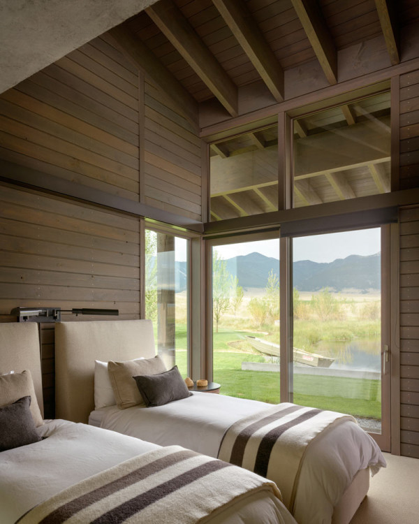 Every space including guest bedrooms features cool views of the ponds and nature