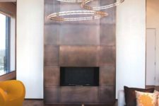 12 a fireplace highlighted with copper panels for safety and a bold modern look
