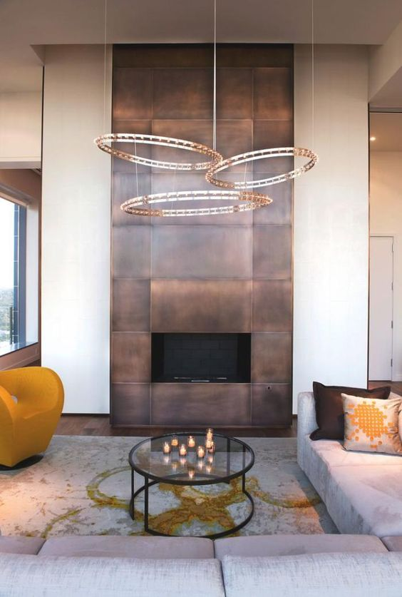a fireplace highlighted with copper panels for safety and a bold modern look