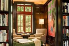 12 an oversized green upholstery ottoman with a refined design adds to the study style