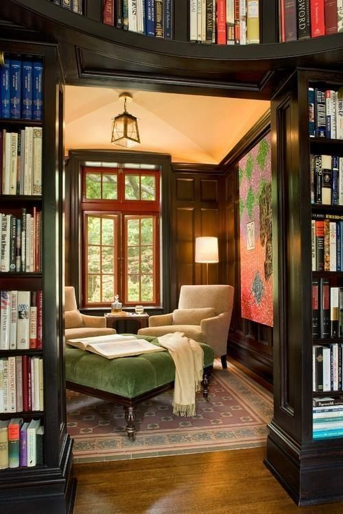 an oversized green upholstery ottoman with a refined design adds to the study style