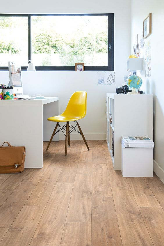 oak-colored laminate is a cool solution for a home office where you move chairs often - it won't scratch that much