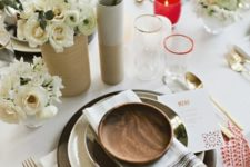 12 simple table decor with black chargers, neutral florals and red candle holders