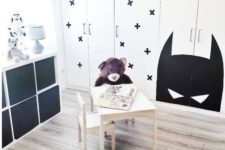 13 a Dombas wardrobe stenciled with black crosses to fit a Scandinavian kid's room