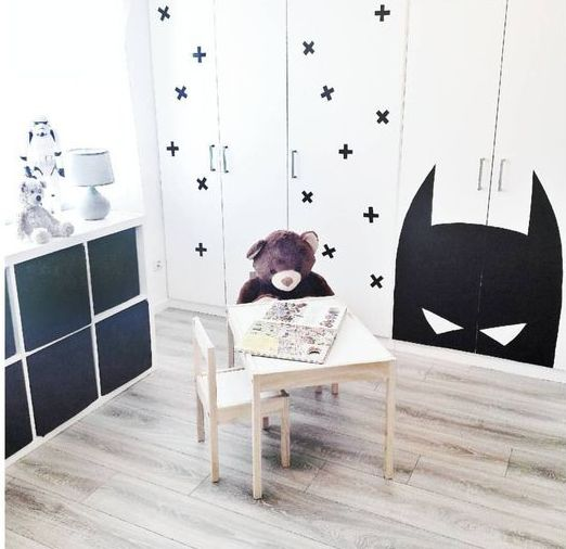 a Dombas wardrobe stenciled with black crosses to fit a Scandinavian kid's room