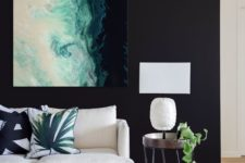 13 a bold statement artwork on a black wall is a chic idea and black will highlight it