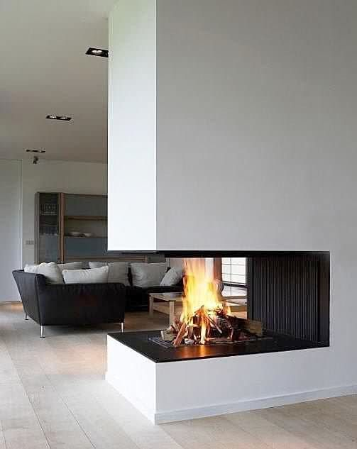 a double fireplace will not only bring coziness everywhere but also become a focal point in both spaces