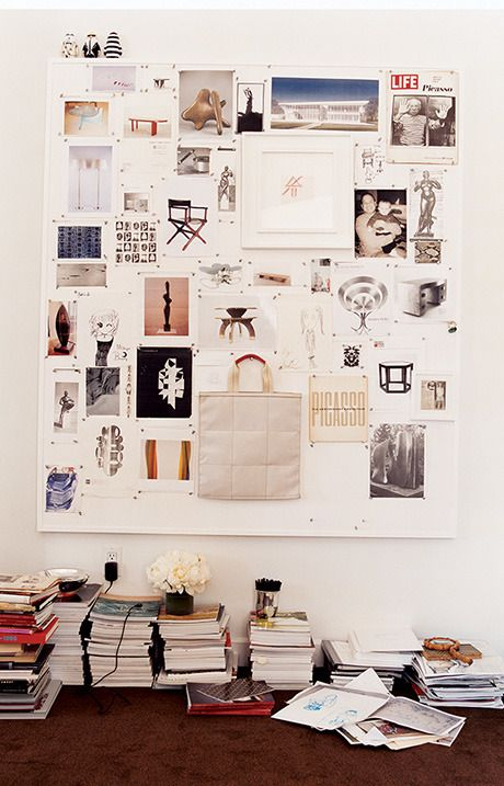 a framed pinboard upholstered with some fabric is a great idea for any space