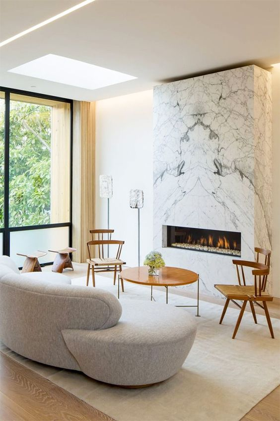 a marble clad wall unit with an ethanol fireplace for a refined look