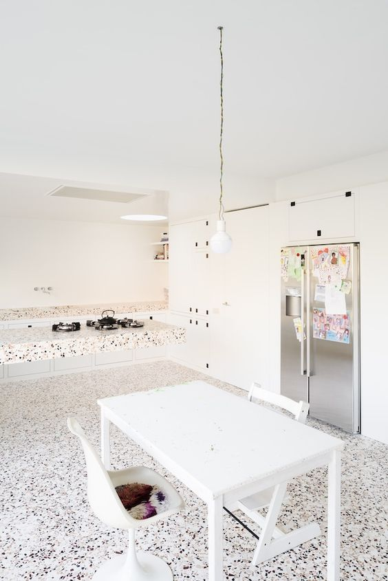 a terrazzo floor, countertops and a floating kitchen island for a trendy look