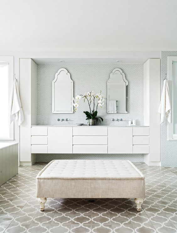 an oversized neutral upholstered ottoman as a comfy seating in your bathroom