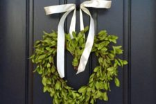 14 a boxwood heart wreath with a ribbon bow to decorate the front door