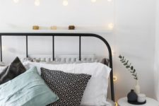 14 a ledge with cute printables in frames and string lights create a welcoming and cozy ambience