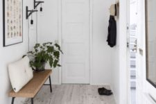 14 a minimal entryway with a metal and cork bench that is perfectly cozy and comfy