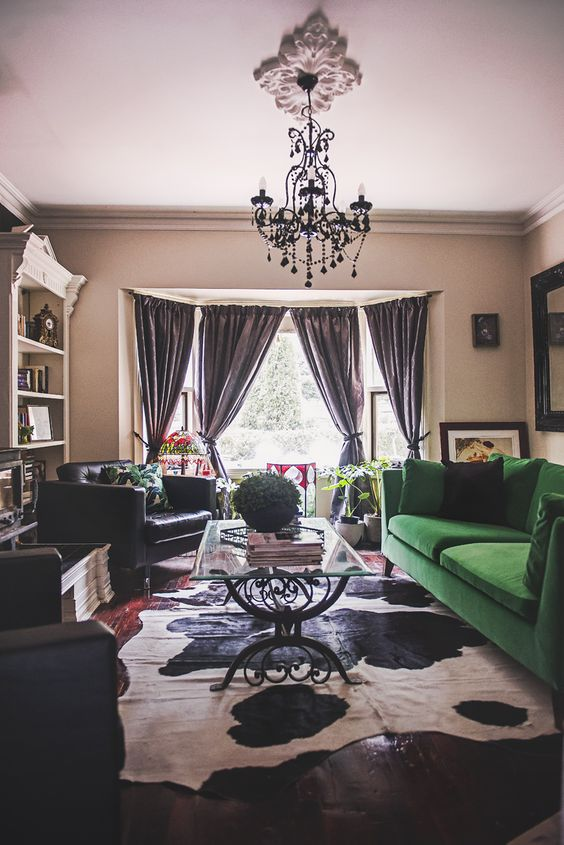 a moody living space with a bold splash - an emerald green Stockholm sofa that makes a statement