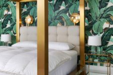 15 a bold tropical leaf wall and a thick framed brass bed make a cool combo