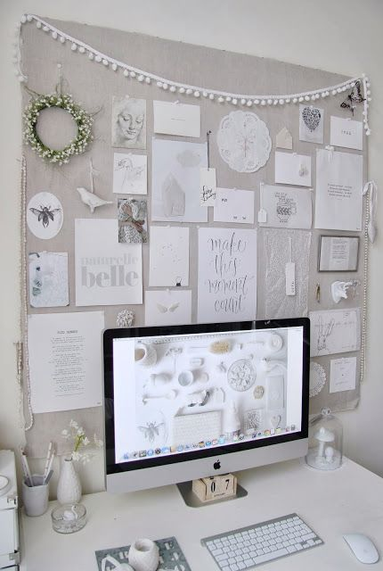 a large pinboard covered with light grey fabric for a light shabby chic or vintage feel