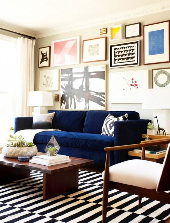 A Navy Stockholm Sofa Makes A Colorful Statement In This Monochromatic Space