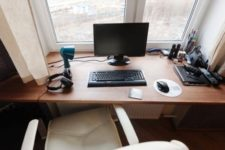 15 a small working space on the windowsill and a comfy white leather chair
