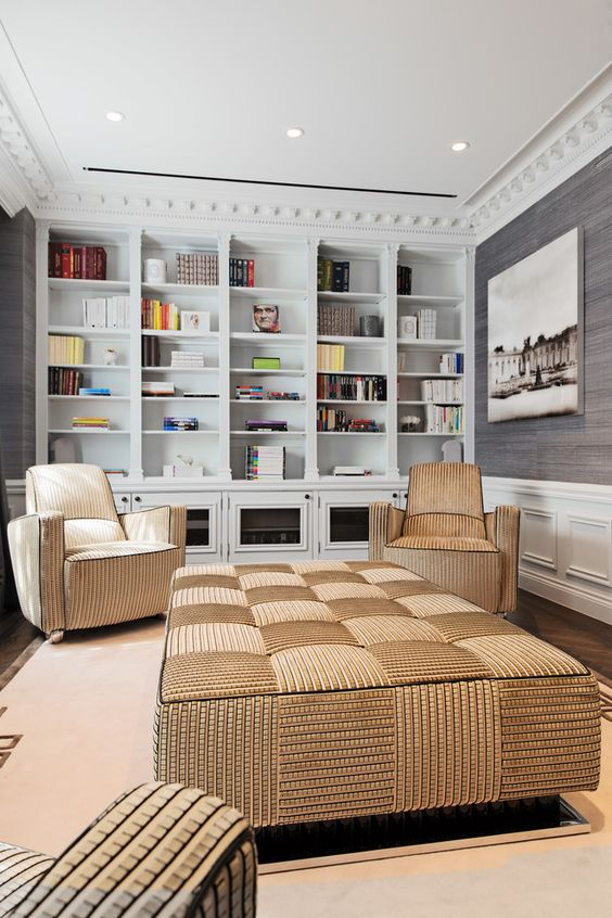 an oversized upholstered checked ottoman and matching chairs for the reading zone