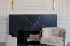 15 black marble brings a refined feel to the space and prevents the top from heating