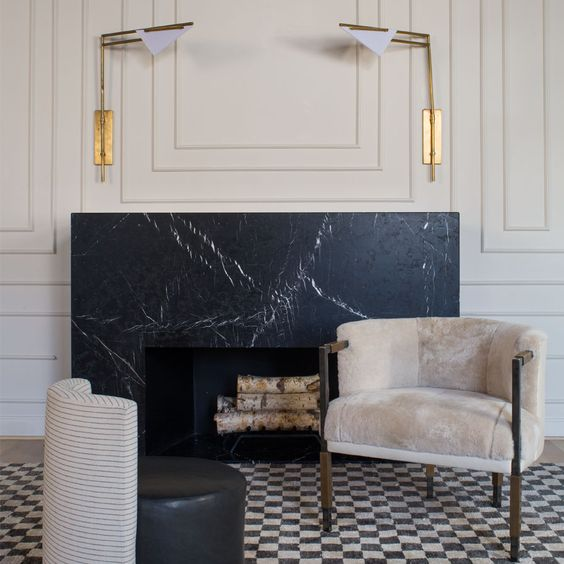 black marble brings a refined feel to the space and prevents the top from heating