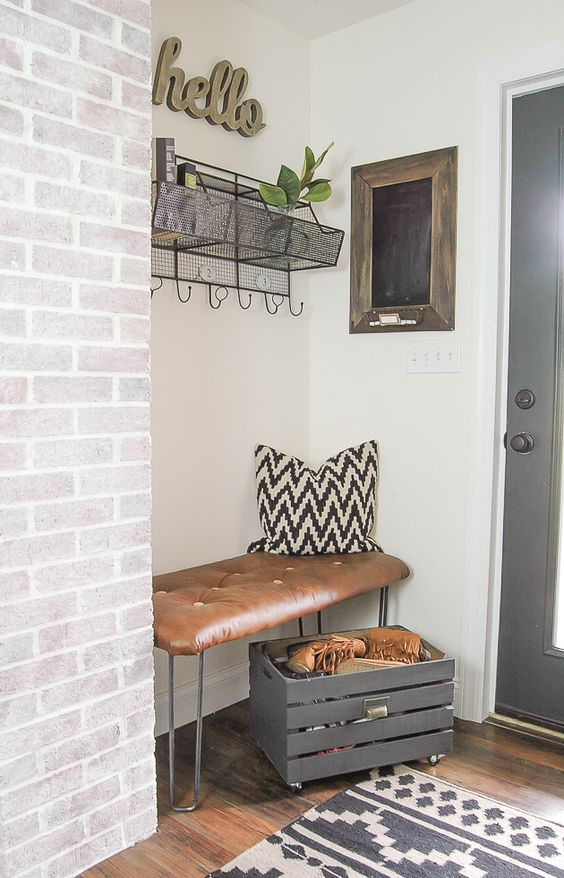 brign an industrial feel to your space with a hairpin leg and leather bench in the corner