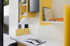 16 a colorful modern workspace with a floating desk and some colorful geometric shelves