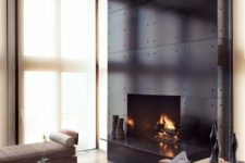 16 a fireplace accentuated with black metal panels looks chic and a bit industrial