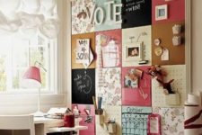 16 a large pinboard covered with various types of fabric to create a bold and eclectic look