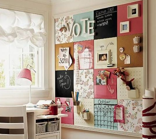 a large pinboard covered with various types of fabric to create a bold and eclectic look