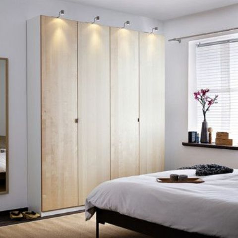 light-colored plywood doors with little handles make the wardrobe cool and chic