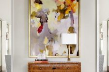 17 a bold colorful artwork makes a statement in this entryway