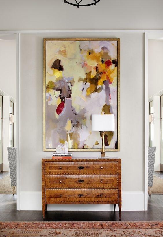 a bold colorful artwork makes a statement in this entryway