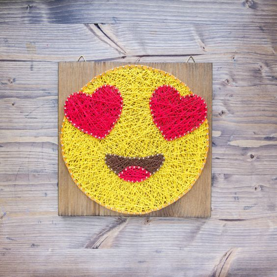 a bold string art with in love emoji is a chic modern piece for decor