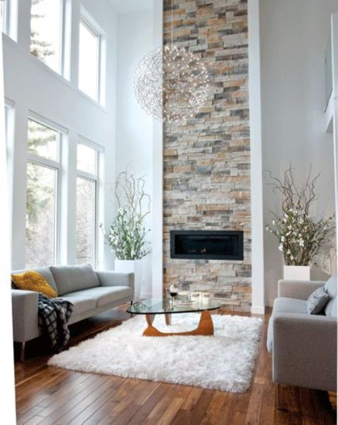 a built-in fireplace highlighted with a vertical brick stripe coming up to the ceiling