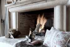 17 a chic large fireplace with some sitting space for cozy evenings