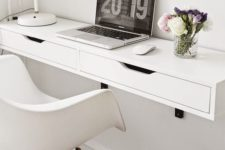 17 a comfy white floating desk with a couple of drawers for hiding some stuff
