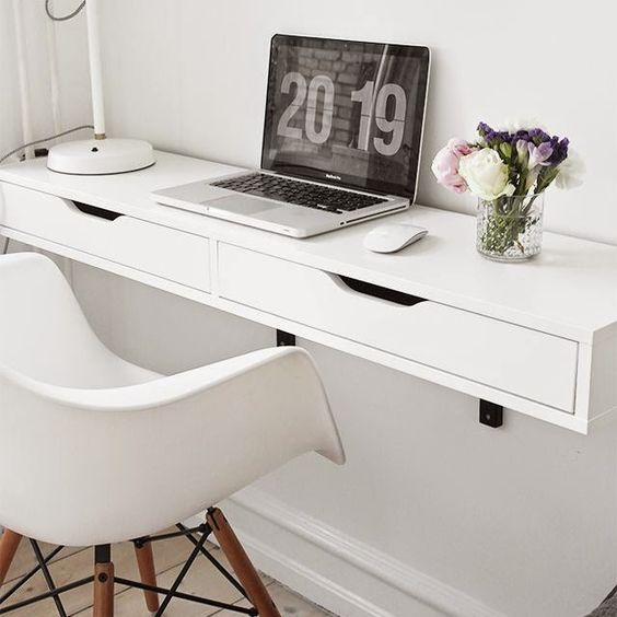 a comfy white floating desk with a couple of drawers for hiding some stuff