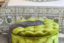 17 a large green grass upholstered ottoman provides storage and works as a bedroom bench