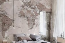 17 a large map wall mural on the headboard wall is ideal for travel fans