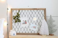 17 a small pinboard upholstered with fabric with a grid print and a refined vintage frame